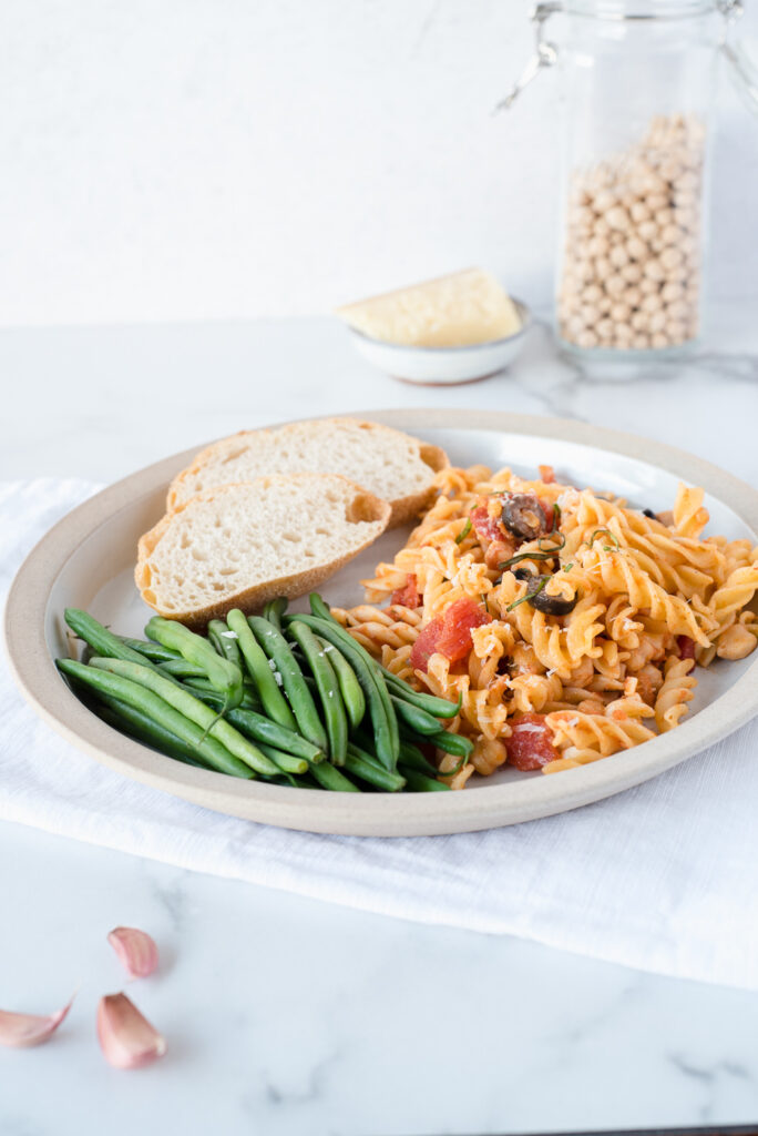Large plate with pasta, green beans, and sourdough bread