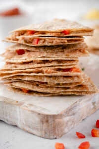 Close up of a stack of cut quesadillas