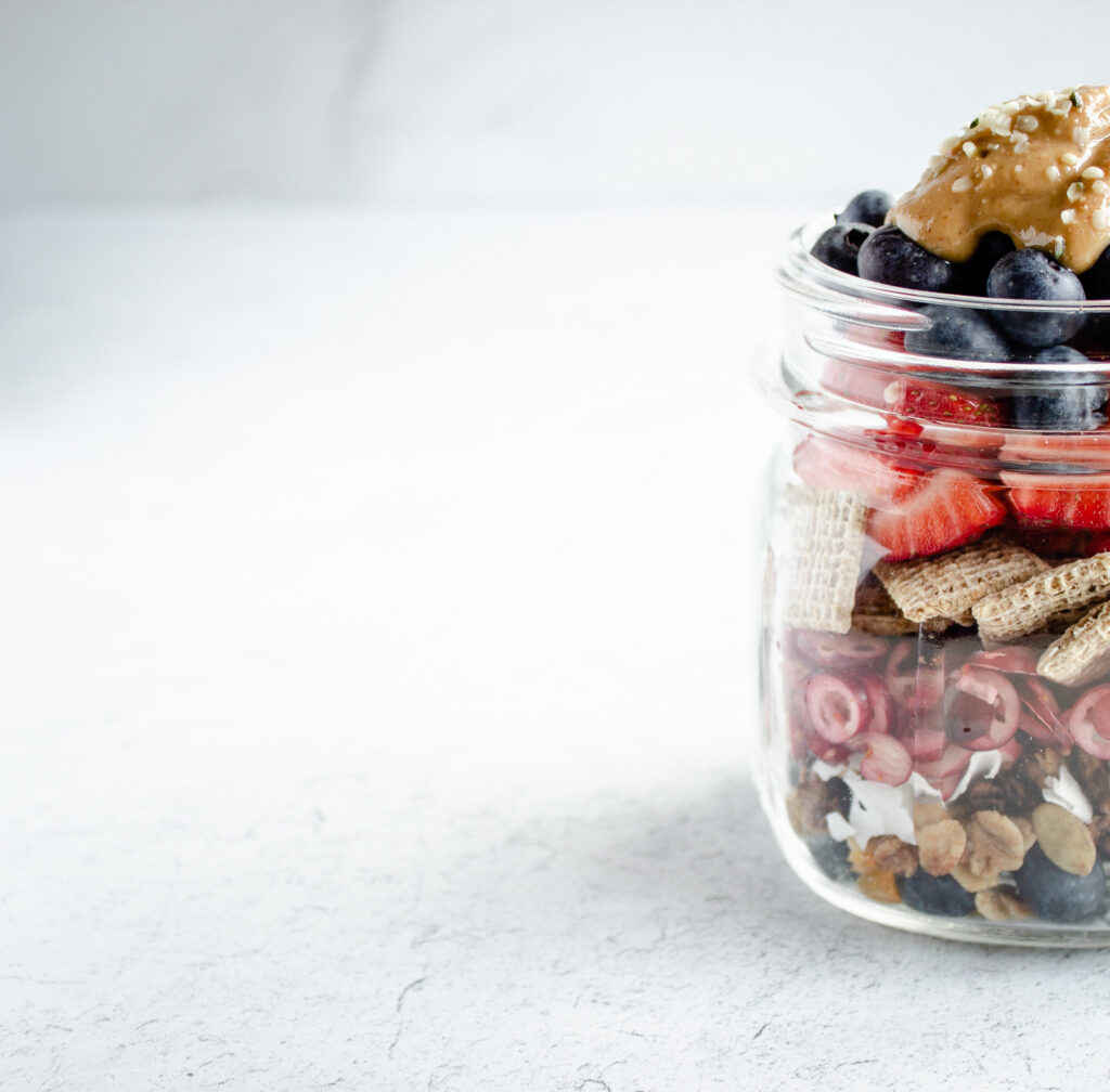 The left half of a mason jar filled with fruit and cereal