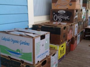 Produce boxes stacked on a porch