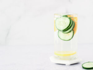 Glass of water with cucumbers slices
