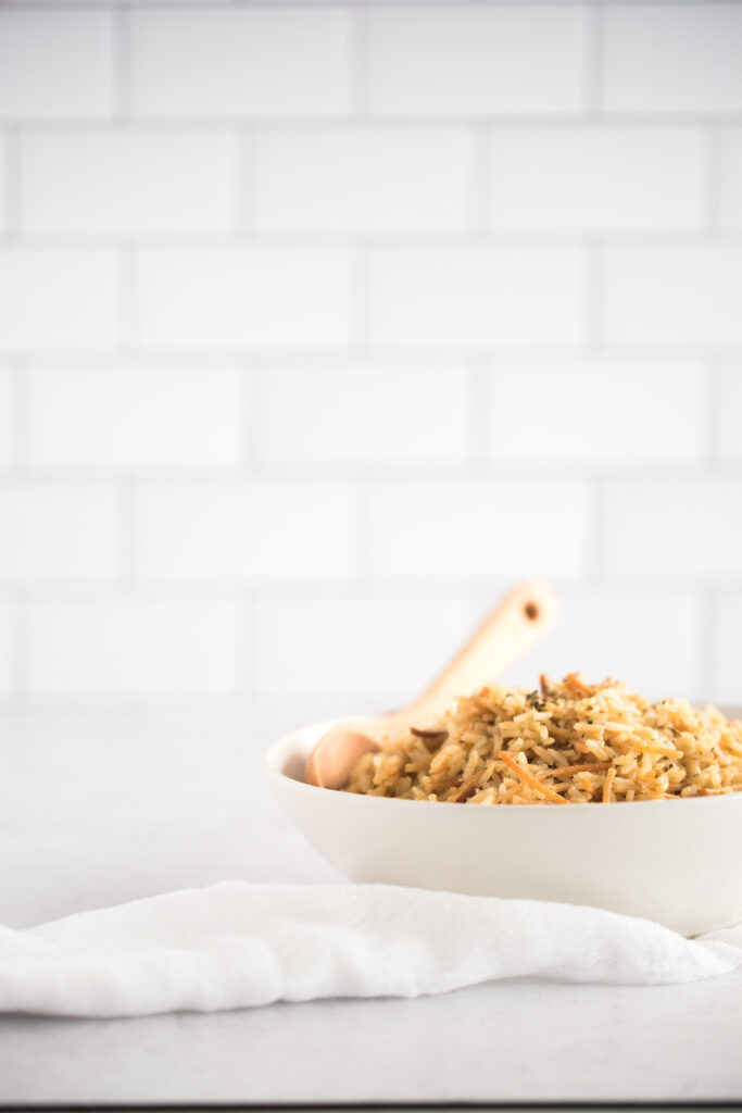 Side view of a white bowl filled with rice