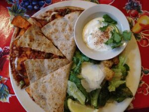 Top down view of quesadillas on a plate