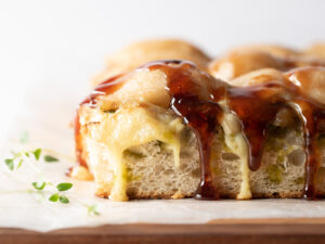 Close up of a slice of focaccia with pears and cheese on top