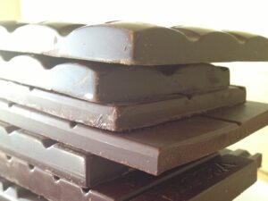 Stack of unwrapped dark chocolate bars