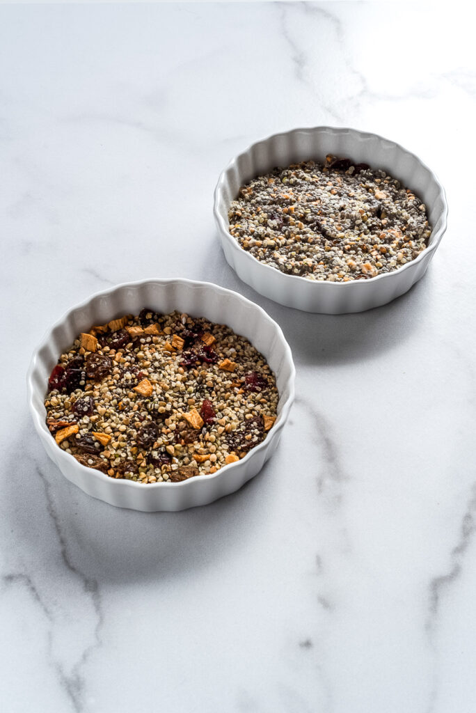 Two bowls of seeds and dried fruit cereal