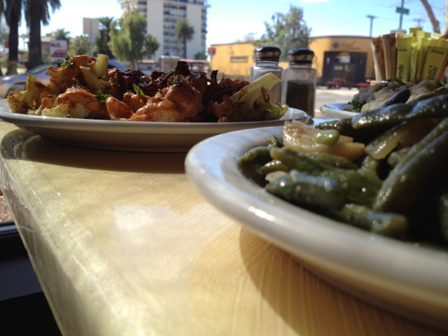 Caramelized cauliflower and green beans on table