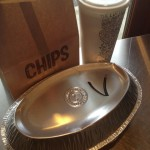Chipotle vegetarian bowl to go with chips and a drink