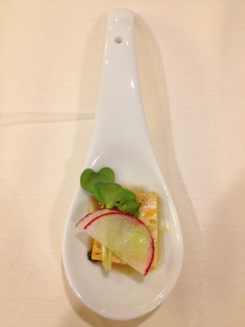 One bite of tofu with radish and sunflower sprouts