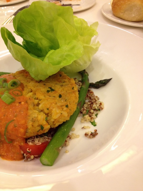 Veggie burger on plate with asparagus and quinoa