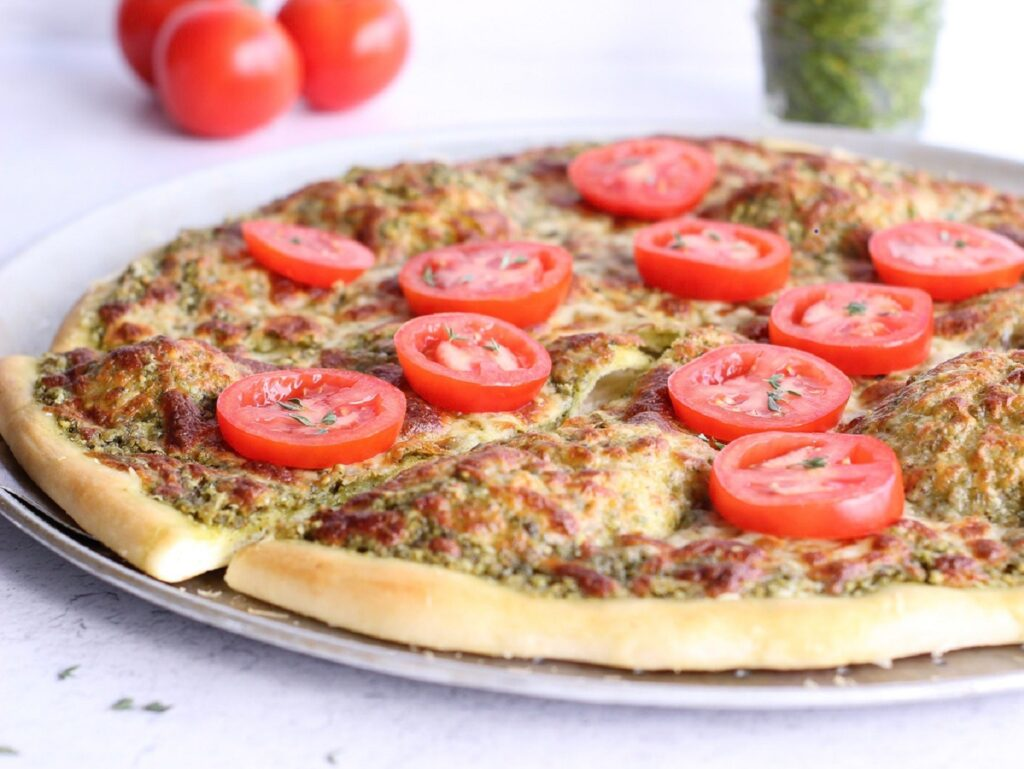 Pizza with tomatoes on top