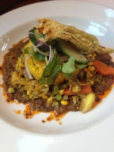 Risotto corn cake on a bed of lentils