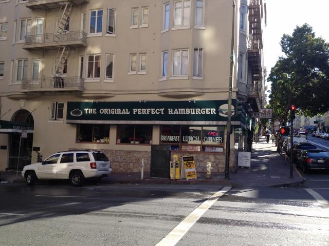 Sign on restaurant claiming the original perfect hamburger