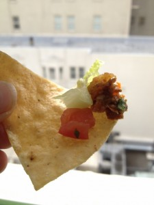 Tofu, tomato and lettuce on a tortilla chip