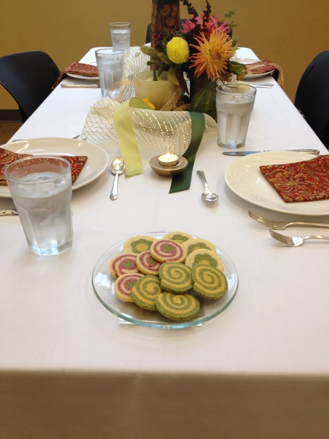 Plate of swirled shortbread cookies on a fancy linen tablecloth