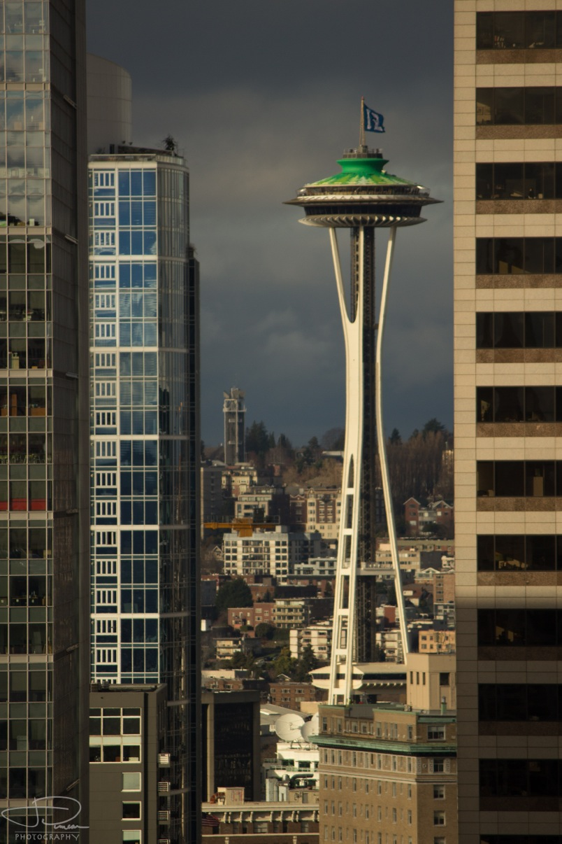 Space needle as seen between buildings