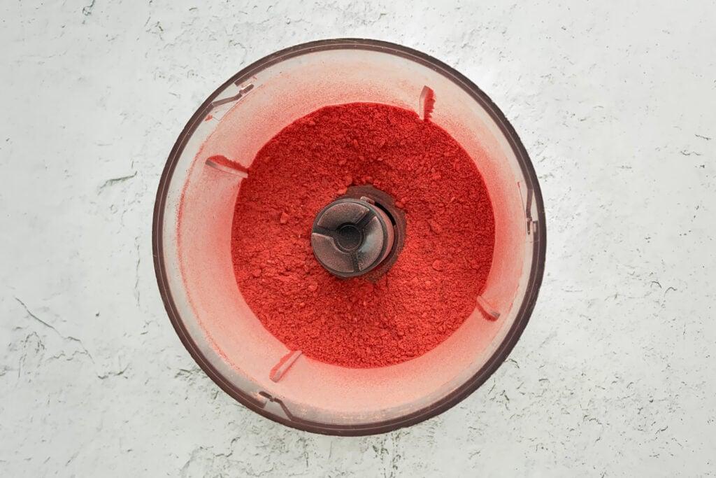Food processor full of strawberry powder