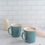 Two mugs of strawberry milk
