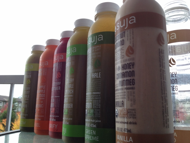 6 bottles of Suja juice lined up side-by-side
