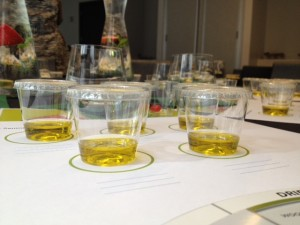 Small plastic cups full of olive oil for tasting