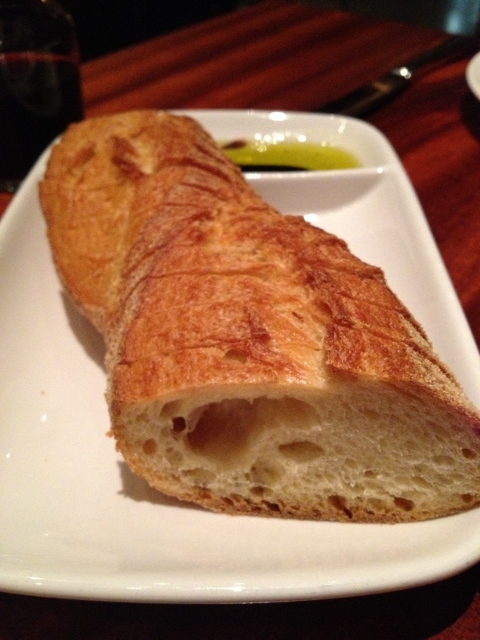 Loaf of Italian bread with olive oil for dipping
