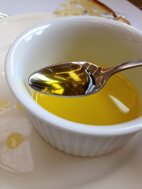 Bowl of camelina oil with spooon