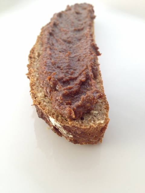 Homemade Nutella spread on a piece of whole wheat bread