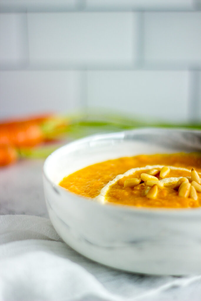 Close up of a bowl of carrot soup