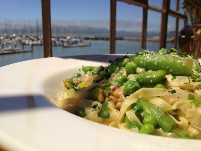 Linguini with snap and English peas, spring onions and pine nuts