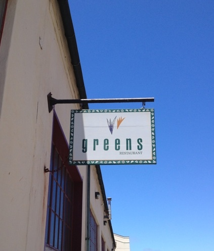 Sign for Greens Restaurant outside the front door