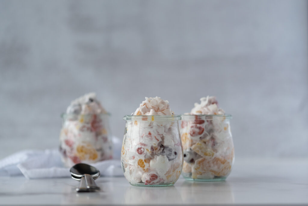 Three small jars filled with ambrosia salad
