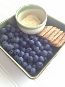 6 crackers, 1 cup blueberries, 2 tablespoons hummus