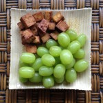 3 ounces salty tofu bites and 1 cup grapes