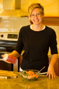 Woman shaking jar of salad dressing