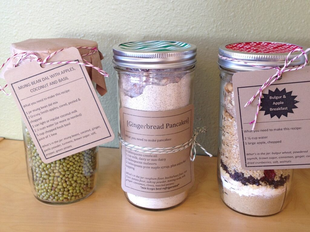 3 canning jars filled with ingredients and tied with recipe cards