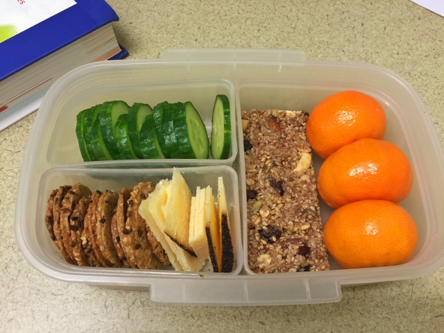 Mandarins, cucumber, cheese, crackers, granola bar bento lunch