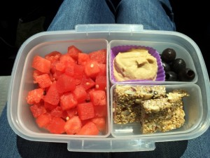 Watermelon, hummus, olives, granola bar bento lunch