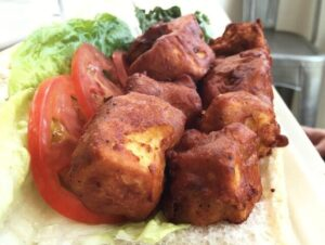 Deep fried tofu cubes on bread with lettuce and tomato