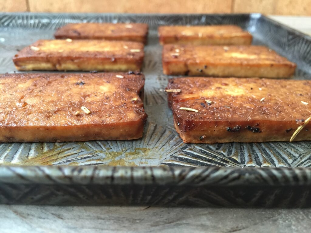 Piece of baked tofu on a cookie sheet