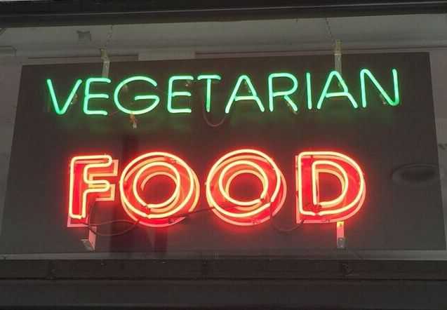 Neon vegetarian food sign