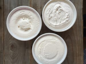Top down view of 3 tubs of whipped topping