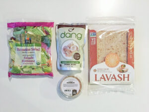 Bags of lettuce, coconut chips and lavash bread