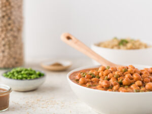 Bowl of garbanzos and peas in tomato sauce