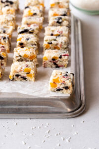 Sheet pan topped with fruity coconut treats