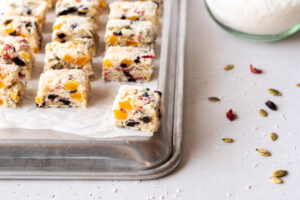 Coconut fruit candies on a baking sheet