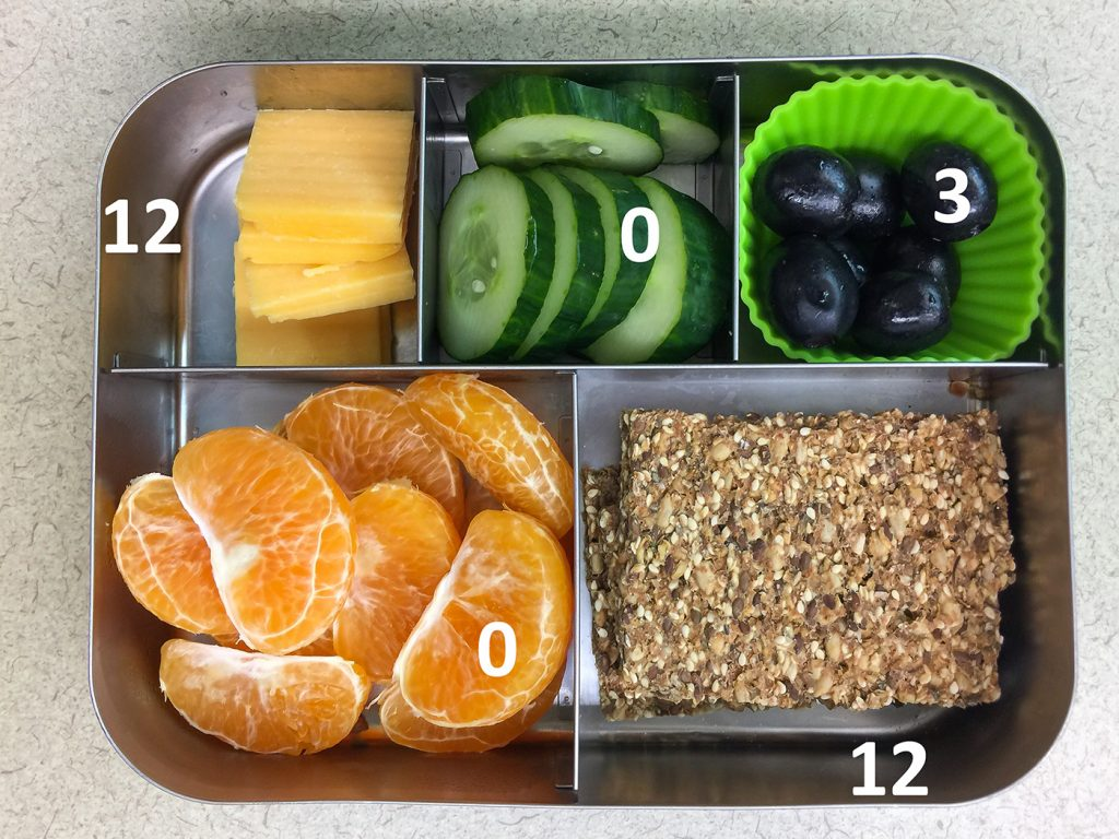 Crispbread and cheese bento with fruit and veggies and fat grams