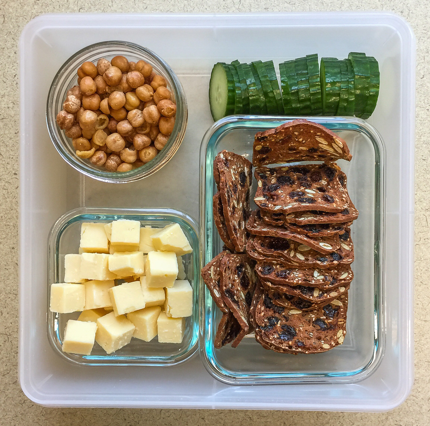 Healthy snacks at work cheddar, chickpeas, cucumber, crackers