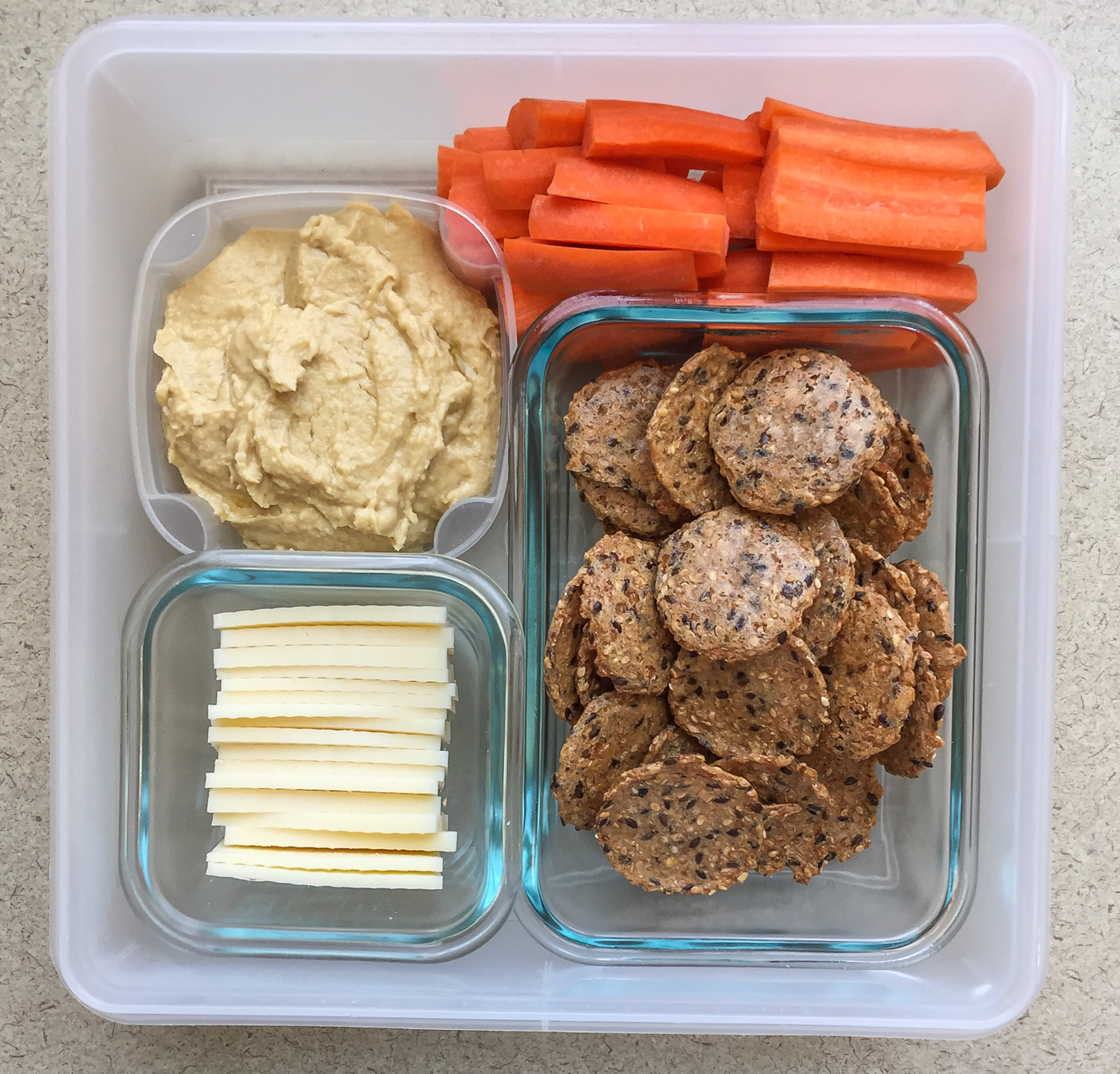 Healthy work snacks hummus, carrots, Mary's Gone Crackers, mozzarella cheese