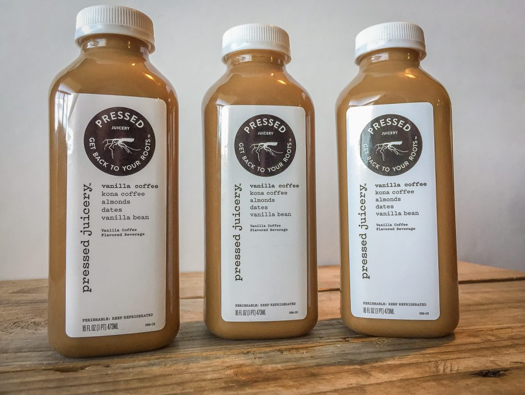 Three bottles of Pressed Juicery Vanilla Coffee