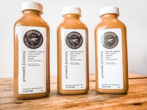 3 bottles of Pressed Juicery Vanilla Coffee